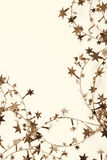 Golden stars and spangles as holiday background. In Sepia toned. Stock Photography