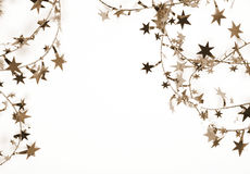 Golden stars and spangles as holiday background. In Sepia toned. Stock Photos