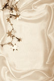 Golden stars and spangles on silk as background. In Sepia toned. Stock Photo