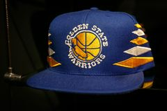 Golden State Warriors hat. New York, October 20, 2017: Golden State Warriors hat on sale in the NBA store in Manhattan royalty free stock photography