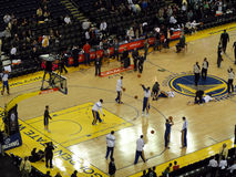 Golden State Warriors players take shoots during warm up session stock photography