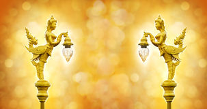 Golden statue of angel hold the lamp on the bokeh  background Stock Photography