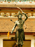 Golden statue of an archer, Rama of Hinduism at the Kings palace, Bangkok, Thailand.  Royalty Free Stock Images