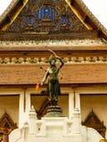 Golden statue of an archer, Rama of Hinduism at the Kings palace, Bangkok, Thailand.  Royalty Free Stock Photos