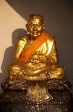 Golden statue of Ban Huai Mongkhon Royalty Free Stock Photography