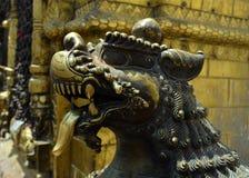 Golden Statue of beast lion in Swayambhu Stupa Royalty Free Stock Photography
