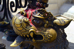 Golden Statue of beast lion in Swayambhu Swayambhunath Stupa Royalty Free Stock Images