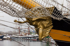 Golden statue on the bow of a ship Royalty Free Stock Image