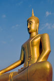 Golden statue of Buddha bathed in morning light Stock Photography