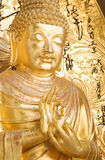 Golden statue of Buddha. In buddhist monastery royalty free stock images