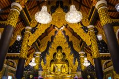 The golden statue of Buddha in church of Wat Phra That Doi Phra Chan, Temple in Lampang Thailand. royalty free stock photography