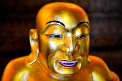 The Golden statue of Buddha. The face of the Golden statue of Buddha stock photography