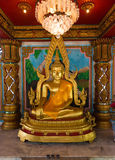 Golden Statue of the Buddha inside Li Thi Miew Shrine Stock Photo