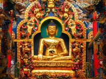 Golden Statue of Buddha inside Namdroling Monastery. In Kushalnagar near Madikeri, Karnataka, India. It is the largest teaching center of the Nyingma lineage of Stock Photo
