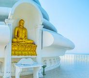 The golden statue. The statue of Buddha, Touching Eart at Japanese Peace Pagoda, located on Rumassala Mount, Unawatuna, Sri Lanka royalty free stock images