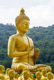 Golden statue of buddhist saint and buddha Royalty Free Stock Images