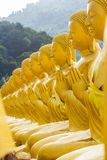 Golden statue of buddhist saint Stock Images