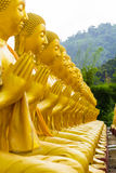Golden statue of buddhist saint Royalty Free Stock Image