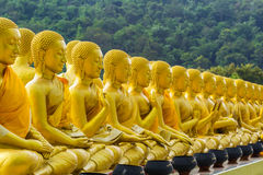 Golden statue of buddhist saint Royalty Free Stock Photo