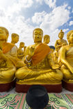 Golden statue of buddhist saint Stock Image