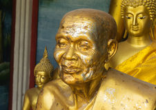 Golden statue in buddhist temple Stock Photos