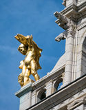 Golden statue on building in Antwerp Stock Photos