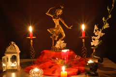 Golden statue and candles Stock Photo