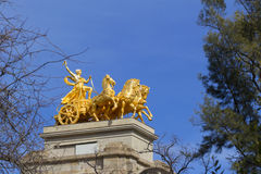 Golden statue of a chariot Stock Photo