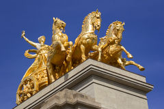 Golden statue of a chariot Royalty Free Stock Photography
