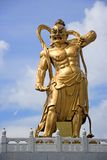 Golden statue of Chinese deity Stock Photography