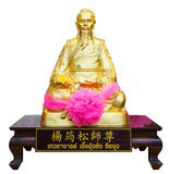 Golden statue of a Chinese god isolated on white background Royalty Free Stock Photo