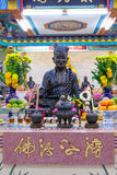 Golden statue of a Chinese god Royalty Free Stock Images