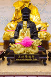 Golden statue of a Chinese god Royalty Free Stock Photos