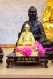 Golden statue of a Chinese god Stock Photo