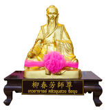 Golden statue of a Chinese god Stock Photography