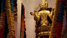 Golden statue of deity on the street in Pattaya, Thailand stock video footage
