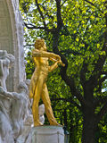 Golden statue of famous composer Johann Strauss at Stadtpark, downtown Vienna Stock Photo