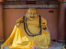 Golden Statue of the fat laughing Buddha Royalty Free Stock Photography
