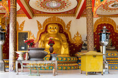 Golden statue of fat laughing Buddha in the temple Royalty Free Stock Image