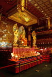Three Buddha Statue. Golden Statue found at Buddha Tooth Temple Royalty Free Stock Photo