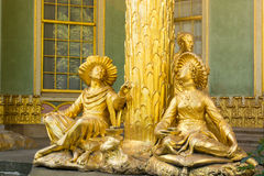 Golden statue in front the Chinese house royalty free stock images