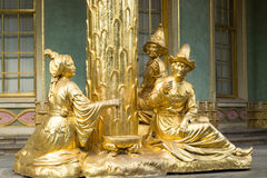 Golden statue in front the Chinese house stock image