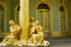 Golden statue in front the Chinese house Royalty Free Stock Image