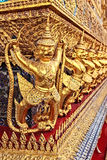 Golden Statue of Garuda catching Naga Royalty Free Stock Photography