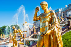 Golden statue at Grand cascade fountains, St. Petersburg, Russia Royalty Free Stock Photos