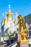 Golden statue at Grand cascade fountains in Petergof, St. Petersburg, Russia Stock Images
