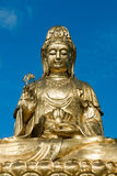 Golden Statue of Guan Yin Stock Image