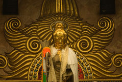 Golden statue  of Guan Yin Buddha 2. Stock Images