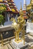 Golden statue guarding temple. At Wat Phra Kaeo Stock Image