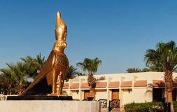 A golden statue of Horus a falcon headed by the Egyptian god of royalty free stock images